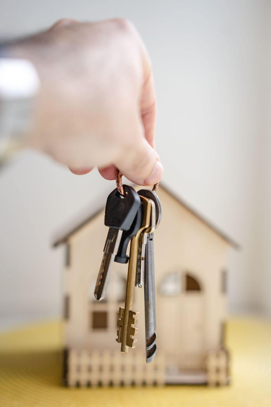 person with keys for real estate